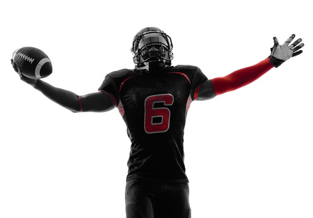een American football-speler in silhouet schaduw op witte achtergrond Stockfoto