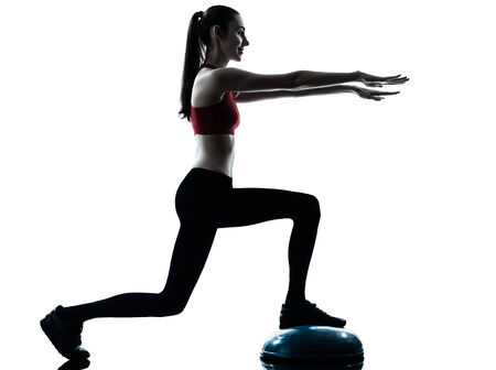 lunges: one  woman exercising bosu balance ball trainer in silhouette studio isolated isolated on white background