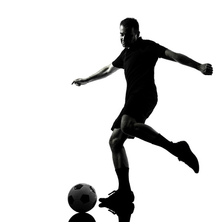 one man soccer player in studio silhouette isolated on white background Stock Photo - 30154041