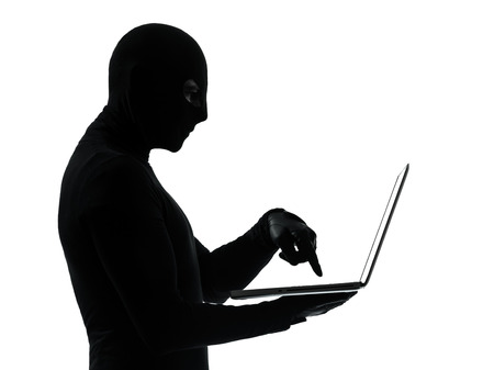thief criminal computer hacker in silhouette studio isolated on white background Stock Photo - 30154055