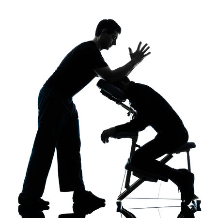 chair massage: two men performing chair back massage in silhouette studio on white background