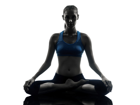 One Woman Exercising Yoga Sukhasana Easy Pose In Silhouette Studio Isolated On White Background