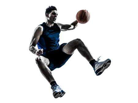 basketball player: one  man basketball player jumping in silhouette isolated white background