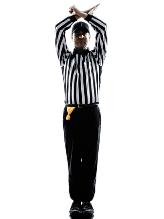 foul: american football referee gestures personal foul in silhouette on white background Stock Photo