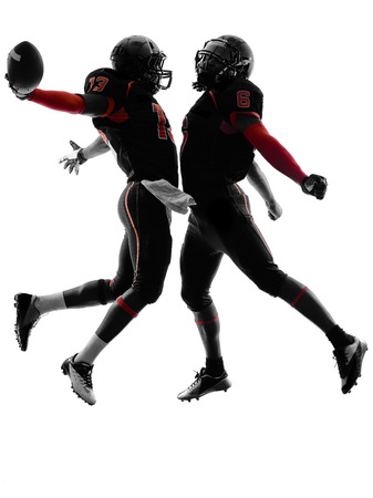 winning: two american football players in touchdown celebration silhouette shadow on white background Stock Photo