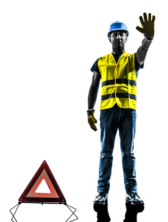 one signals safety warning triangle man stop gesture with safety vest silhouette isolated in white background photo