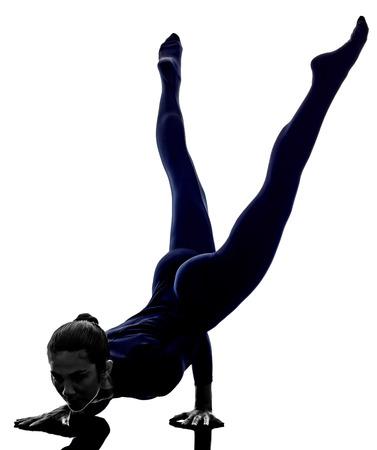 asanas: woman exercising Mayurasana peacock pose yoga silhouette shadow white background Stock Photo