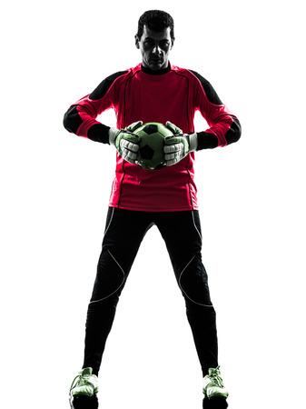 arquero futbol: un hombre de fútbol portero jugador de pie la celebración de balón en silueta aislado fondo blanco