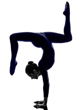 woman exercising Eka Pada Viparita Dandasana pose yoga silhouette shadow white background Stock Photo