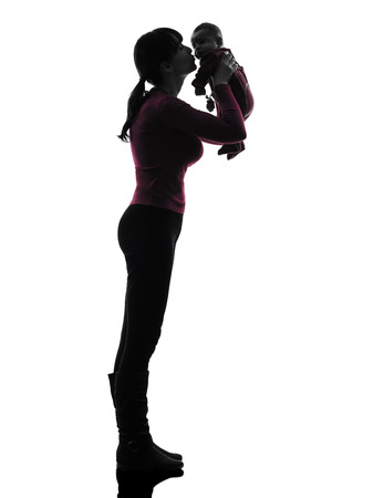 one  woman holding kissing baby silhouette on white background photo