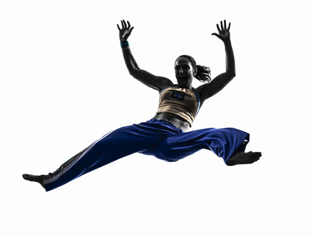 one  woman capoeira dancer dancing in silhouette studio isolated on white background photo