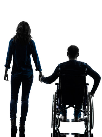 one handicapped man and woman holding hands in silhouette studio on white background photo