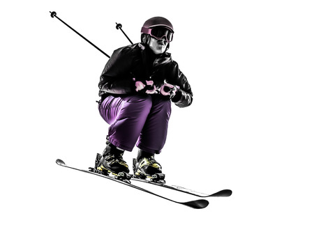 one  woman skier skiing jumping in silhouette on white background photo