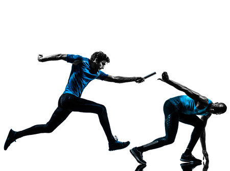 relay race: two men relay running sprinting in silhouette studio isolated on white