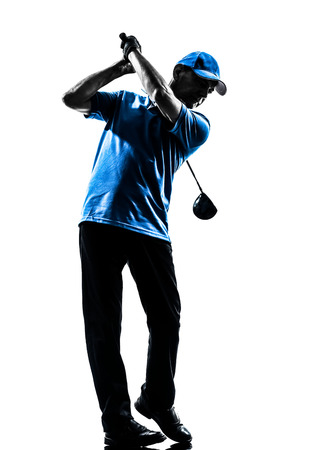 one man golfer golfing golf swing in silhouette studio isolated on white  Фото со стока
