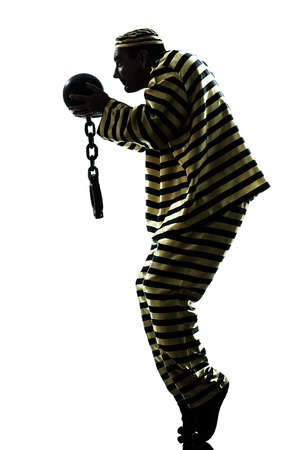 prisoner ball: one  man prisoner criminal escaping with chain ball silhouette in studio isolated on white  Stock Photo