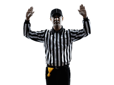american football referee gestures in silhouette on white Imagens - 32430588