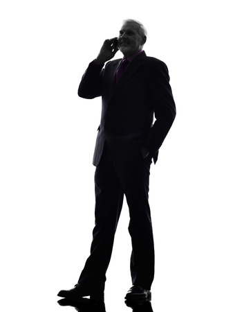 senior business man: One Caucasian Senior Business Man on the telephone smiling Silhouette White