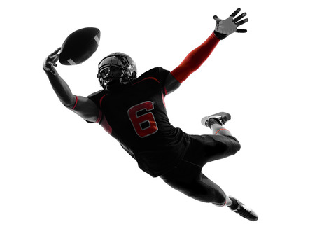 player: one american football player catching ball in silhouette shadow on white  Stock Photo