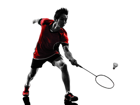 badminton: one asian badminton player young man in silhouette isolated white