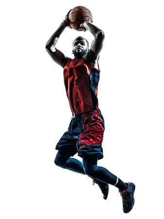 uniforms: one african man basketball player jumping throwing in silhouette isolated white  Stock Photo