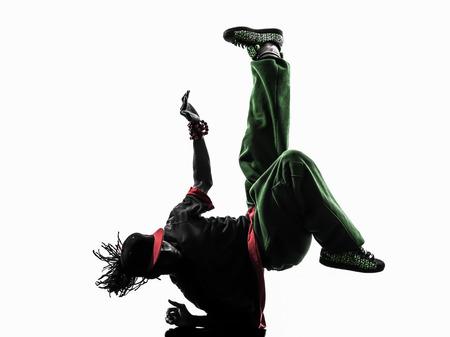 one hip hop acrobatic break dancer break dancing young man handstand silhouette white  Stock Photo