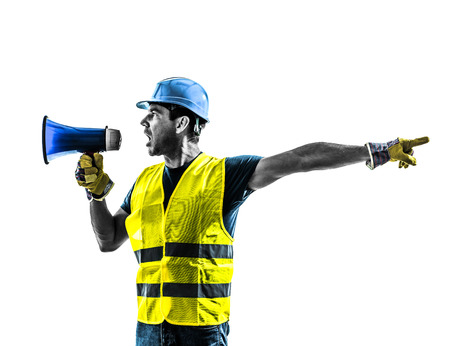 one construction worker signaling with safety vest silhouette isolated in white  Imagens