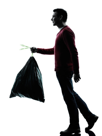 dumping: man dumping garbage bag in silhouettes on white