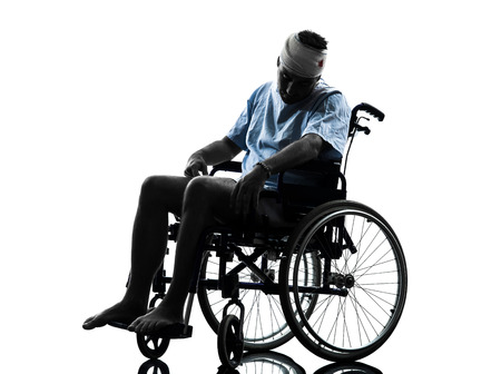 patients: one injured man in wheelchair sleeping in silhouette studio on white