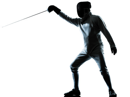 fencers: one man fencing silhouette in studio isolated on white