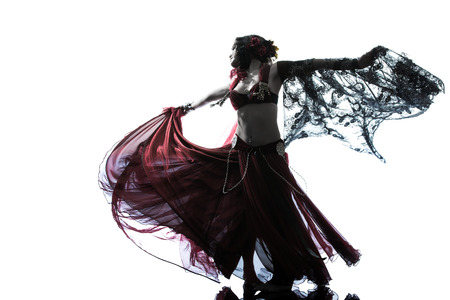 tummy: one arabic woman belly dancer dancing silhouette studio isolated on white