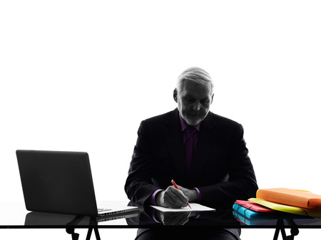 senior business man: One Caucasian Senior Business Man busy working writing Silhouette White  Stock Photo