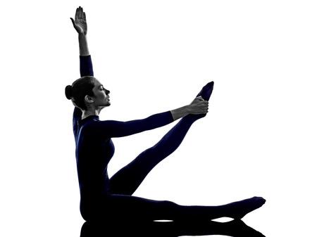 asanas: woman exercising stretching yoga silhouette shadow white background