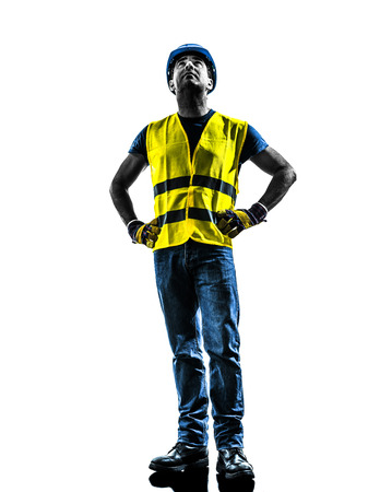 safety vest: one construction worker looking up with safety vest silhouette isolated in white background
