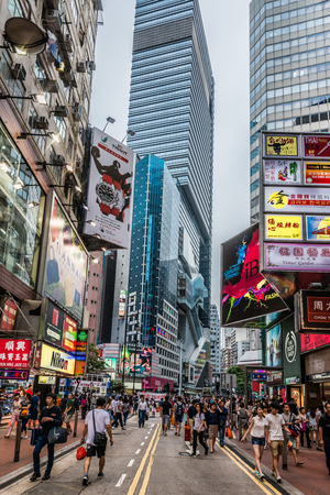 bay: causeway bay, hong kong, china - june 6, 2014: people shopping in the streets of causeway bay Editorial
