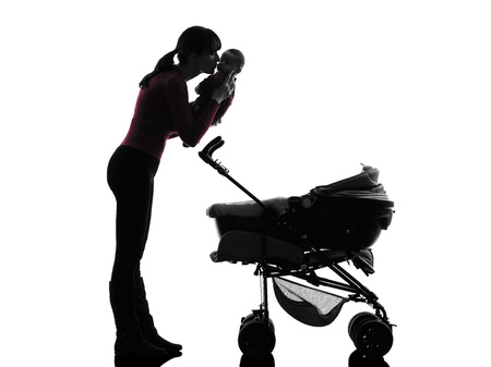 one woman prams holding baby kissing silhouette on white background photo