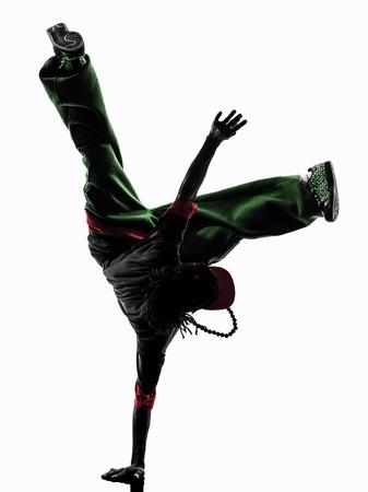 bailarines silueta: un bailarín de Hip Hop descanso acrobático breakdancing silueta fondo blanco joven hombre de parada de manos Foto de archivo