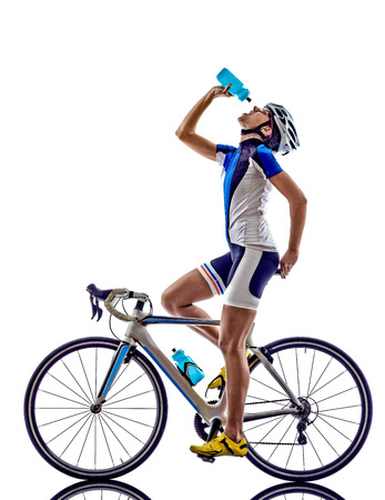 woman triathlon ironman athlete  cyclist cycling drinking on white background Stock Photo