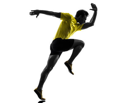 one  man young sprinter runner running in silhouette studio on white background photo