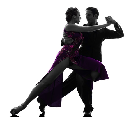 one  couple man woman ballroom dancers tangoing in silhouette studio isolated on white background Stockfoto