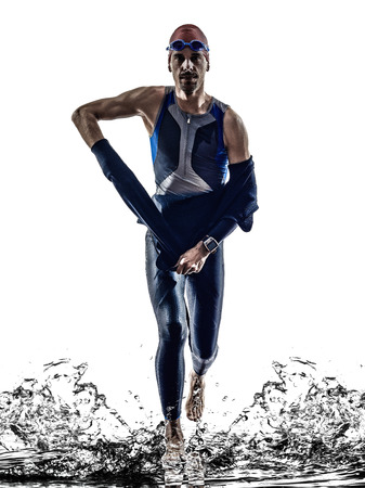 man triathlon iron man athlete swimmers swimmers running in silhouette on white background photo