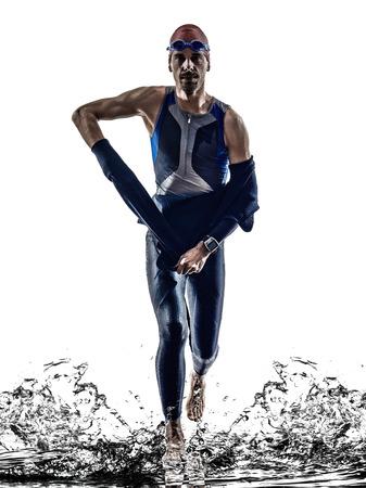 man triathlon iron man athlete swimmers swimmers running in silhouette on white background