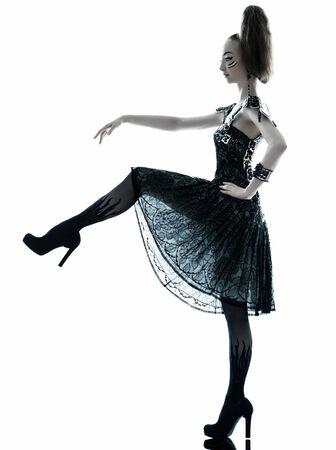haute couture: young beautiful woman fashion model in on aura tout vu silk black fantasy haute couture summer dress in studio white background