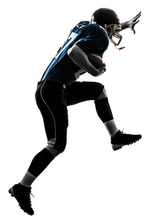 american football background: one  american football player man running in silhouette studio isolated on white background