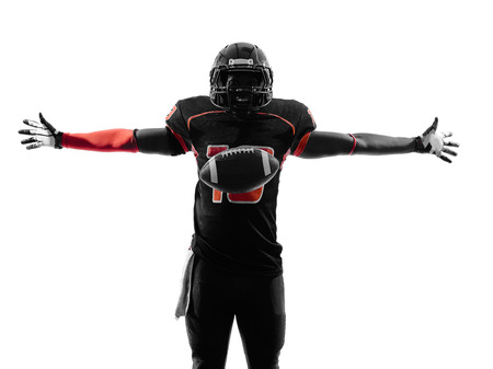 one american football player touchdown celebration in silhouette shadow on white background photo