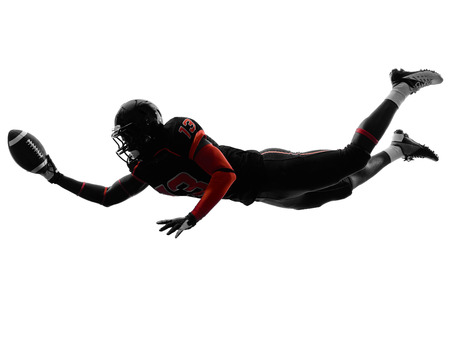 player: one american football player scoring touchdown in silhouette shadow on white background Stock Photo