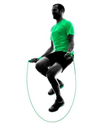 één man te oefenen springtouw fitness in silhouet op een witte achtergrond Stockfoto
