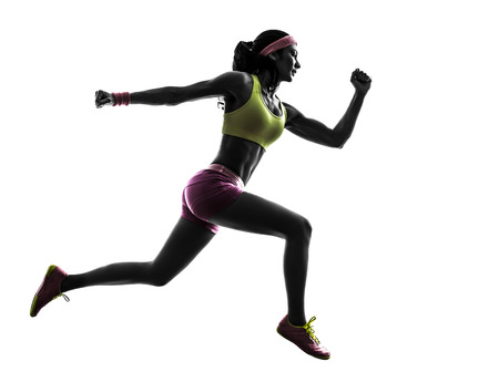 one  woman runner running jumping in silhouette on white background photo