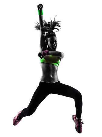 dancer silhouette: one  woman exercising fitness dancing jumping in silhouette on white background