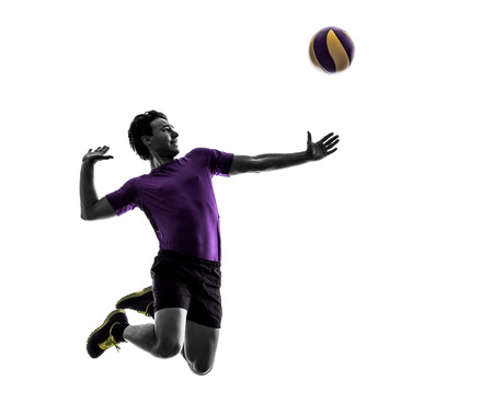 young volley ball player man in silhouette white background Foto de archivo